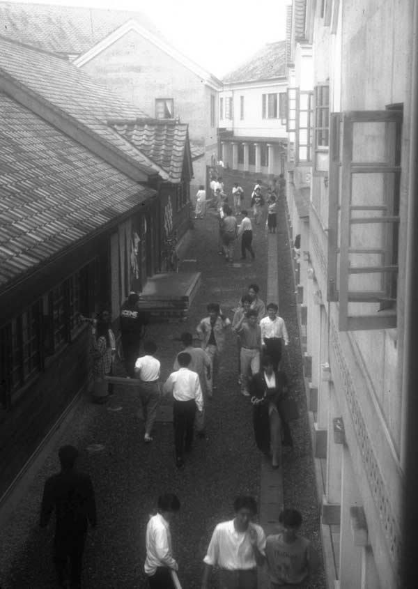students on an internal street of the campus