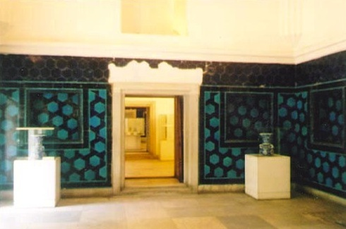 A turquoise and black geometric ornamentation